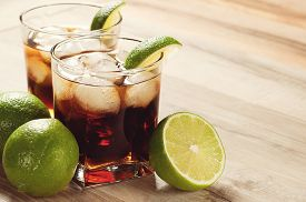 picture of coca-cola  - Cocktail with cola and ice on a wooden table - JPG