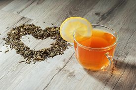picture of dry grass  - Cup of tea on a wooden table - JPG
