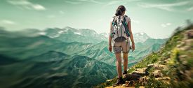 picture of mountain-range  - Woman hiking in mountain range - JPG