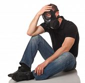picture of s10  - caucasian sit man wearing classic rubber gas mask - JPG