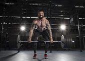 Attractive Muscular Bodybuilder Doing Heavy Deadlift Exercise In poster