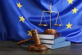 Judge gavel and books with scales on European Union flag background poster