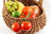 foto of tangelo  - Antique wicker basket filled with fresh fruit and vegetables  - JPG