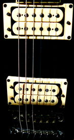 stock photo of ibanez  - a close up of the pick on an ibanez guitar - JPG