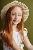Beautiful Red-haired Girl With Long Hair And Beautiful Big Blue Eyes. Redhead Girl Child In Summer C poster
