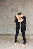Couple Of Dancers In Romantic Position. Full Length Portrait Of Beautiful Dancers Wearing Black Suit poster