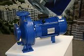 stock photo of centrifuge  - The water centrifugal pump with the electromotor - JPG