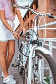 Woman Girl Standing In The Park By Bike. In The Summer In The City, In A Lock With A Chain, Unlocks  poster