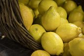The Lemons In A Wicker Basket For Sale In Borough Market poster