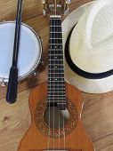 A Samba Player (sambista) Hat And Two Brazilian Musical Instruments: Cavaquinho (small Acoustic Guit poster