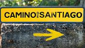 Traditional Yellow Arrow Painted On The Way. Direction Sign For Pilgrims In Saint James Way, Camino  poster