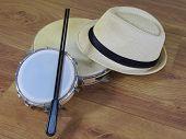 A Samba Player (sambista) Hat And Two Brazilian Percussion Musical Instruments: Pandeiro (tambourine poster