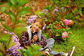 In Love With Spring. Happy Boy Enjoy Spring Blossom. Little Boy Relax In Spring Garden. No Spring Sk poster