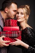Young Couple Together, Close, Holding Red Box Gift, Love And Tenderness, Studio Portrait. Birthday,  poster