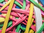 Closeup of tangled colorful rubber bands poster