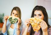 Young Beautiful Women Eating Slices Of Taste Italian Pizza At Home - Happy Pretty Sisters Covering T poster
