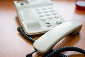 Modern Digital Phone, Isolated On Wooden Background.the Image Of Telephone. Voip Telephone Conferenc poster