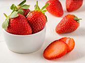 Fresh Ripe Strawberries In Small White Bowl. Strawberry In Bowl On Oriental White Background poster