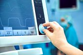Monitoring Patients Vital Sign In Operating Room. Doctor Cheking At Patients Vital Signs. Cardiogram poster