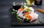 Vegetarian Vietnamese Spring Rolls With Spicy Sauce, Carrot, Cucumber, Red Cabbage And Rice Noodle.  poster