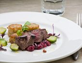 stock photo of deer meat  - Deer steak with cranberries potatoes pie and brussels sprouts - JPG
