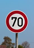 Traffic Sign Speed Limit 70 Against Blue Sky