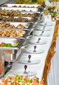 stock photo of catering service  - metallic banquet meal trays served on tables - JPG