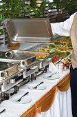 image of chafing  - chafing dish heater filled with ready food inside - JPG