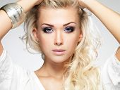 Beautiful Blond Woman With Saturated Makeup.