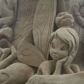 stock photo of tinkerbell  - Sandsculpture Tinkerbell on the beach of Noordwijk Netherlands - JPG