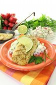 image of hake  - hake with lime on potato salad and chives on a bright background - JPG