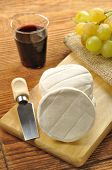 pic of tomas  - Italian tomino cheese on a wooden chopping board italian appetizer - JPG