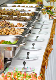 foto of buffet catering  - metallic banquet meal trays served on tables - JPG