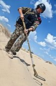 foto of landmines  - iraqi soldier in the desert with army metal detector - JPG