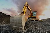 stock photo of granite  - Image of a wheeled excavator on a quarry tip - JPG