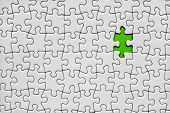 Jigsaw puzzle with one green piece missing