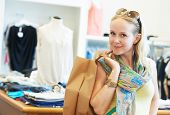 pic of apparel  - woman buyer with apparel purchase during garments clothing shopping at clothes store - JPG