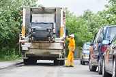 pic of trash truck  - Worker of municipal recycling garbage collector truck loading waste and trash bin - JPG