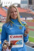 DONETSK, UKRAINE - JULY 14: Alena Lutkovskaya of Russia with her silver medal in pole vault during 8