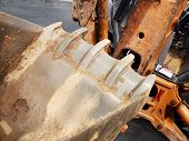 picture of backhoe  - Closeup looking into the bucket of backhoe on a front end loader for construction - JPG