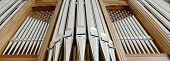 stock photo of pipe organ  - organ pipes close up in a circle - JPG