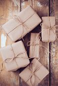 Постер, плакат: Gift Boxes Postal Parcels On Wooden Board