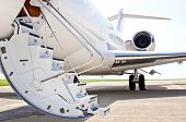 stock photo of propeller plane  - Stairs with Jet Engine on a modern private jet airplane  - JPG