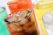 stock photo of cold drink  - Colorful soda drinks with cola soft drinks with ice cubes - JPG