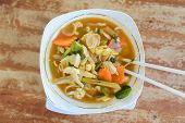 stock photo of malay  - Malay style spicy soup with chopsticks on the table - JPG