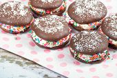 image of sprinkling  - Whoopie pies chocolate cake desserts decorated with sprinkles and sugar shallow depth of field - JPG
