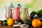 stock photo of fruit shake  - Healthy diet protein shakes fruits and sport and fitness concept [[** Note: Shallow depth of field] ** Note: Soft Focus at 100%, best at smaller sizes - JPG