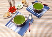 stock photo of saucepan  - Tasty soup in saucepans on tablecloth - JPG