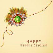pic of rakhi  - Beautiful rakhi on beige background for Happy Raksha Bandhan celebrations - JPG