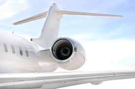 picture of aeroplan  - Running Jet Engine on a modern private jet airplane with a wing  - JPG
